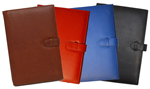 black, tan, red and blue leather planners