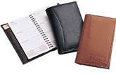 inside and outside views of black and brown leather pocket secretaries